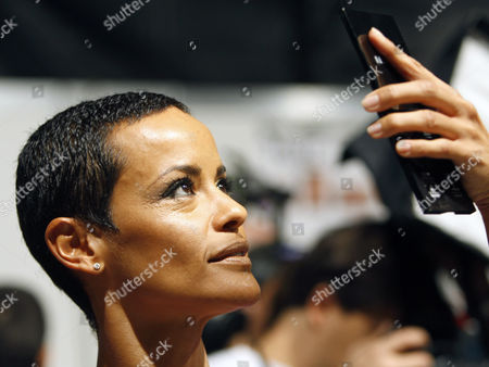 Nadege du Bospertus French model Nadege du Bospertus checks her make-up in the backstage prior to the DSquared2 Spring/Summer 2009 fashion collection presented in Milan, Italy