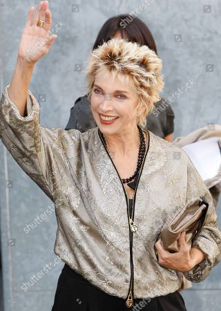 """Stock Picture of Mariangela Melato Italian actress Mariangela Melato waves to photographers prior to the start of the Giorgio Armani Spring/Summer 2009 fashion collection, presented in Milan, Italy. Melato, 71, known for her critically acclaimed performance as a spoiled socialite stranded with a sailor she had tormented in the 1974 film comedy """"Swept Away"""" has died in a Rome hospital. The Antea hospital said she died Friday, Jan. 11, 2013. The LaPresse news agency said she was suffering from pancreatic cancer. The blonde actress obtained her most success in a series of films in the 1970s directed by the Italian Lina Wertmuller, including """"The Seduction of Mimi"""" and """"Love and Anarchy"""