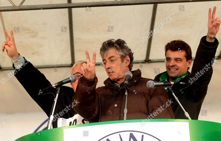 Lega Nord(Northern League) party leader Umberto Bossi, center, President of the Lega Nord in Turin Roberto Cota, right, and Lega Nord's Mario Borghezio do the victory sign during a demonstration in Turin, northern Italy, . The demonstration was to celebrate the final approval by the Italian Senate in November of a constitutional reform pushed by the autonomy-minded Northern League