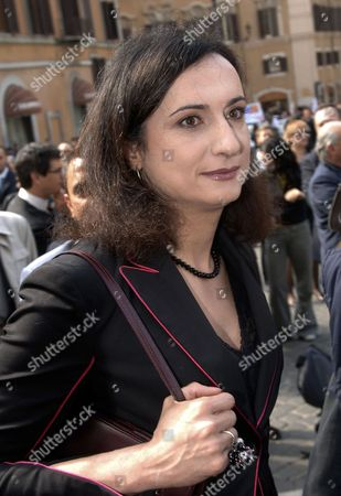 """Vladimir Luxuria Then Italian Communist Refoundation Party lawmaker Vladimir Luxuria, Italy's first transgender lawmaker, arrives at the Lower Chamber in Rome. Italy's foreign minister Emma Bonino said in a Tweet, that her country is working for the release in Sochi, the site of the Olympic Winter Games, of Luxuria. Italian Daily Corriere della Sera quoted an Italian advocate for gay rights, Imma Battaglia, as saying Luxuria called to say she was arrested by police in Sochi while attending the games with a flag with the slogan, in Russian, """"Gay is OK"""