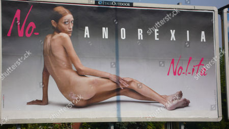 A giant poster showing a naked emaciated woman, part of a campaign against anorexia by Italian photographer Oliviero Toscani, in Milan, Italy, Tuesday, Sept, 25, 2007. The campaign, sponsored by an Italian clothing firm, came up in Italy just as Milan fashion shows started