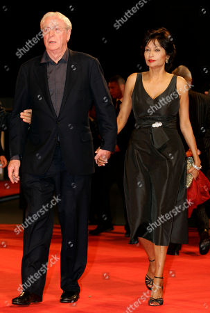 """Stock Photo of Michael Caine, Shakira Baksh British actor Michael Caine arrives with his wife Shakira Baksh for the screening of his latest movie """"Sleuth"""" in competition at the 64th Venice Film Festival, in Venice, Italy"""
