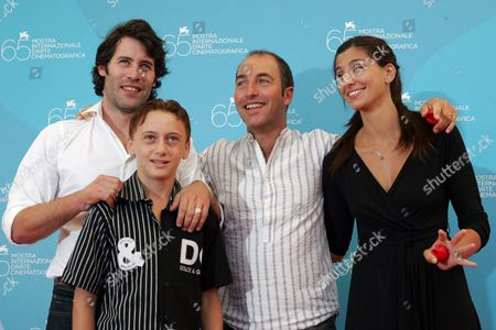 Jalil Lespert; Robert Valeanu; Marco Pontecorvo; Evita Ciri From left, actor Jalil Lespert, young actor Robert Valeanu, director Marco Pontecorvo and actress Evita Ciri pose during the photo call of the movie 'Pa-ra-da' at the 65th edition of the Venice Film Festival in Venice, Italy