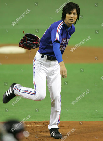 Vic Chou Taiwanese top singer Vic Chou throws the ceremonial first pitch for the game between Taiwan's La New Bears and Japan's Nippon Ham Fighters in the Asia Series baseball tournament at Tokyo Dome in Tokyo
