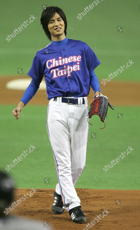 Vic Chou Taiwanese top singer Vic Chou reacts after throwing the ceremonial first pitch for the game between Taiwan's La New Bears and Japan's Nippon Ham Fighters in the Asia Series baseball tournament at Tokyo Dome in Tokyo
