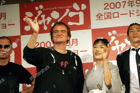 """Quentin Tarantino, Kaori Momoi, Takahashi Miike, Yusuke Iseya U.S. film director and actor Quentin Tarantino, second left, and Japanese actress Kaori Momoi, third left, gesture during a press conference in Tokyo to announce the upcoming Japanese film """"A Sukiaki Western: Django."""" Tarantino plays two roles in the film which is a so-called macaroni-western set in Japan, starring Japanese actors speaking in English, and meant for a Japanese audience. Others are the film's director Takahashi Miike of Japan, left, and Japanese actor Yusuke Iseya, right"""