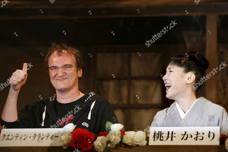 """Quentin Tarantino, Kaori Momoi U.S. film director and actor Quentin Tarantino, left, shows a thumbs-up as Japanese actress Kaori Momoi looks on at a press conference in Tokyo to announce the upcoming Japanese film """"A Sukiaki Western: Django."""" Tarantino plays two roles in the film which is a so-called macaroni-western set in Japan, starring Japanese actors speaking in English, and meant for a Japanese audience"""