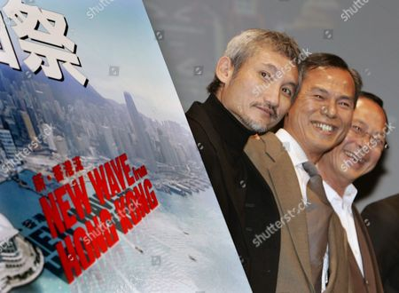 Tsui Hark, Ringo Lam, Johnnie To Hong Kong film directors, from left, Tsui Hark, Ringo Lam and Johnnie To, smile during the opening ceremony of the Hong Kong Film Festival in Tokyo