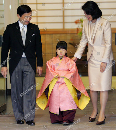 Aiko, Naruhito, Masako Japan's Princess Aiko, clad in traditional ceremonial costume, appears with her father Crown Prince Naruhito and her mother Crown Princess Masako after the Chakko-no-gi ceremony at her residence, Togu Palace, in Tokyo . Princess Aiko, who will turn 5-year-old on Dec. 1, had her first rite of passage as a member of Japan's royal family in the day