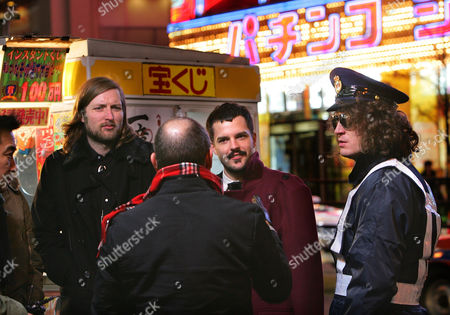 Mark Stoermer, Brandon Flowers, Dave Keuning American rock band The Killers' members, from left, Mark Stoermer, Brandon Flowers and Dave Keuning, speaks to one of the MTV crew in front of a Pachinko parlor during a filming of the Las Vegas native group's MTV video in Tokyo
