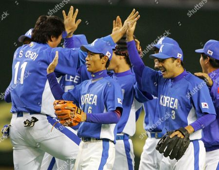 CHOI KIM LEE South Korean players, Choi Hee-seop of the Los Angeles Dodgers (11), Kim Jae-gul (6) and Lee Seung-yeop, celebrate after beating Taiwan 2-0 in their Asia Round game of the World Baseball Classic at Tokyo Dome in Tokyo