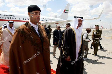 Sheikh Mohammed bin Zayed Al Nahyan, crown prince of Abu Dhabi, is accompanied by Saif al-Islam al-Gadhafi, left,the son of Libyan leader Moammar Gadhafi and President of the Gadhafi Development Foundation, upon his arrival at Tripoli airport, Libya