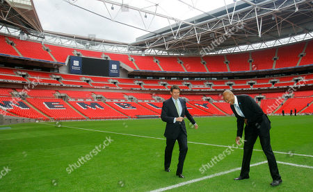 Sebastian Coe, Frank Fredericks Namibia's former athlete Frankie Fredericks, right, jokes with Sebastian Coe, chairman of the 2012 organizing committee, during a visit by the International Olympic Committee to Wembley Stadium in London, . The International Olympic Committee members are on a three day visit to London to inspect venues for the London 2012 Olympic Games