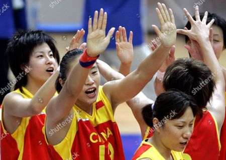 LIU China' Liu Dan, second from left, celebrates with her teamates after defeated Taiwan to won the gold medal in the final of Women's basketball match in the fourth East Asian Games in Macau