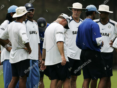 Greg Chappell Indian coach Greg Chappell talks with player and other team officials at the end of a training session in Kuala Lumpur . India will play the West Indies in a tri-nations series game Wednesday