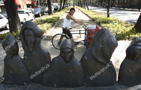 A man looks at a sculpture by British-born Mexican surreal artist Leonora Carrington along Reforma Avenue, in Mexico City. Carrington, considered one of the last of the original surrealists died late Wednesday May 25, 2011. She was 94