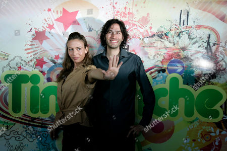 """Sasha, left, and Benny Ibarra, formerly of the Mexican pop group Timbiriche, pose for photographers before a news conference in Mexico City. Ibarra and Sasha along with Erik Rubin launched their album, """"Primera Fila, Sasha, Benny, Erik,"""" in Mexico City, . The disc includes tracks from their solo albums, two covers and two new songs"""