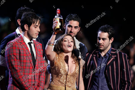 Dalma Maradona, Panda Dalma Maradona, daughter of famous soccer star Diego Armando Maradona holds up a bottle of tequila as she stands with the music band Panda during the 2007 MTV Latin Video Music Awards at the Palacio de los Deportes in Mexico City