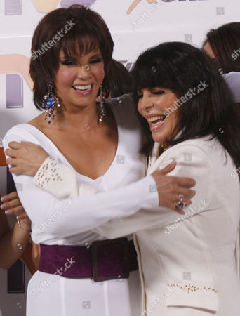 "Lucia Mendez, Veronica Castro Mexican actresses Lucia Mendez, left, and Veronica Castro joke during the presentation of the Mexican TV production ""Mujeres Asesinas,"" or Female Assassins, in Mexico City"