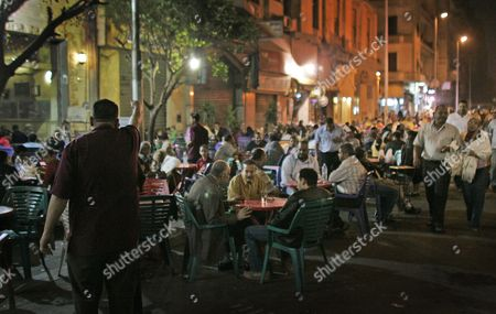 Dated, customers of all shapes and sizes sit at street cafes in central Cairo, Egypt. Almost a third of the world population is now fat, and no country has been able to curb obesity rates in the last three decades, according to a new global analysis released Thursday May 29, 2014, led by Christopher Murray of the Institute for Health Metrics and Evaluation at the University of Washington, USA, and paid for by the Bill & Melinda Gates Foundation. Researchers reviewed more than 1,700 studies covering 188 countries covering over three decades and found more than 2 billion people worldwide classified as overweight or obese. The highest rates of obesity were found in the Middle East and North Africa, with the U.S. having about 13 percent of the world's fat population