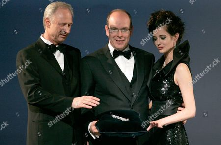 "Prince Albert II of Monaco, Lutz Bethge, Eva Green HSH Prince Albert II of Monaco, center, Lutz Bethge, left, Managing Director of Montblanc International, and Franco-Swedish actress Eva Green present the fountain pen ""Montblanc Prince Rainier III Limited Edition 81."" during a gala in Monte Carlo to celebrate the world première of the ""Montblanc Prince Rainier III Limited Edition 81."", in Monaco. Created to honour Prince Rainier III, who achieved great things, the ?200,000, 18-carat white gold diamond and ruby studded pen is presented to the public for the first time ever. This edition is limited to only 81 pieces worldwide. Fifty-one-percent of all sales revenue will be donated to the ""Princess Grace Foundation"