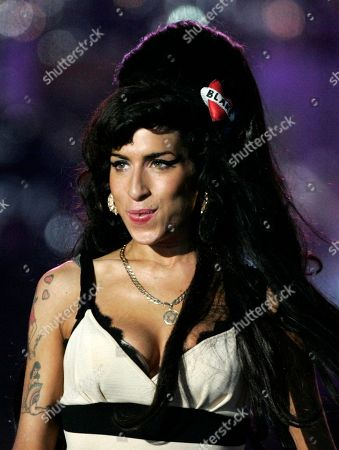 """Amy Winehouse British singer-songwriter Amy Winehouse performs at the 46664 charity concert in honor of Nelson Mandela's 90th birthday in London. Winehouse had written all the songs that were to appear on her third album. She even picked out song titles. But music producer Salaam Remi said the singer was not rushing to release that new material. Only two of the tracks Winehouse wrote were recorded and appear on her compilation album, """"Lioness: Hidden Treasures."""" It will be out on Dec. 5"""