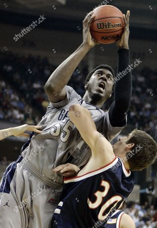 Roy Hibbert, Matthew Dotson Georgetown's Roy Hibbert (55) shoots despite the defense of Belmont's Matthew Dotson during their NCAA East Regional first round basketball game at the Lawrence Joel Veterans Memorial Coliseum in Winston-Salem, N.C