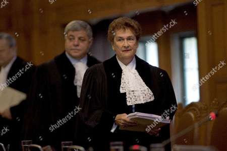 Rosalyn Higgins, Awn Shawkat Al-Khasawneh British President of the Court, Judge Rosalyn Higgins, second right, and Vice-President of the Court Judge Awn Shawkat Al-Khasawneh, right, enter the courtroom of the Great Hall of Justice in The Hague, the Netherlands, . The U.N.'s highest court will settle a long-simmering maritime boundary dispute, carving up rich fishing grounds and oil and gas exploration concessions between Honduras and Nicaragua by drawing a seabed border off the two countries' Caribbean coasts. The binding settlement by the International Court of Justice also will remove a source of tension between the Latin American neighbors that has in the past flared up, with both sides