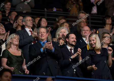 Nobel Peace Prize laureate Al Gore, second left, and his wife Tipper Gore, left, dance with Norwegian Crown Prince Haakon, second right, and Crown Princess Mette-Marit, right, during the Nobel Peace Prize concert in Oslo, Norway, . Artists from all over the world gathered at the Oslo Spektrum to help spread the message of peace and celebrate this year's Nobel Peace Prize laureates - Al Gore and Rajendra Pachauri, chairman of the United Nations Intergovernmental Panel on Climate Change
