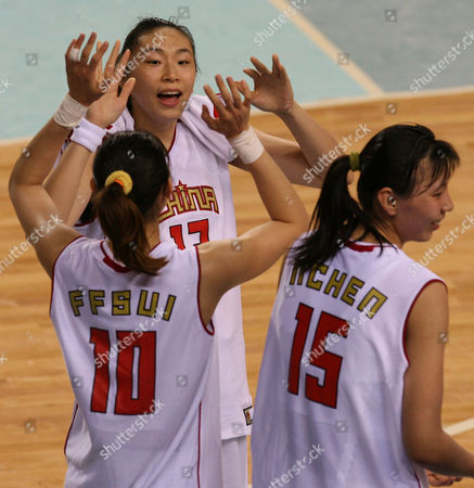 China;s Sui Feifei (10), left front, Liu Dan, left back, and Chen Nan (15) celebrate after defeating Taiwan in the Asian Games Basketball Women's final in Doha, Qatar