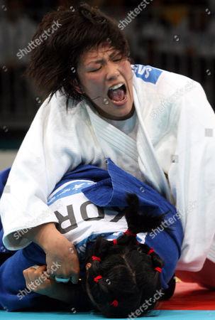 Sae Nakazawa, Lee So-yeon Japan's Sae Nakazawa, white, pushes South Korea's Lee So-yeon down on the mat during the Asian Games judo women's under 78kg final in Doha, Qatar, . Nakazawa topples Lee to win gold