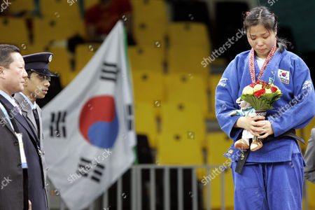 Lee So-yeon South Korea's Lee So-yeon weeps as she is being awarded with silver medal during an awarding ceremony for the Asia Games judo women's under 78kg competition in Doha, Qatar