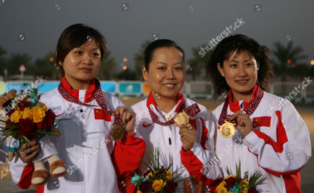 SHOOTING Gold medal winning trio, China's Guo Wenjun, Tao Luna, Chen Ying, from left, display their medals during an awarding ceremony for the Asian Games shooting women's 10m air pistol team final in Doha, Qatar