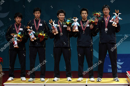 Stock Picture of TENNIS South Korea's men's table tennis team celebrates their silver medal victory, from left Yoon Jae-young, Lee Jung-woo, Ryu Seung-min, Joo Sae-hyuk, Oh Sang-eun after the end of the Men's Table Tennis Team Final competition of the 15th Asian Games in Doha, Qatar, . South Korea lost to China and settled for the silver
