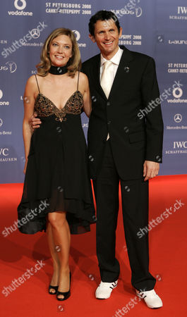 Michael Teuber German cyclist Michael Teuber and an unidentified woman arrive for the Laureus Sports Awards in St. Petersburg, Russia
