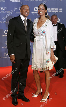 Frankie Fredericks Former runner Frankie Fredericks, left, and an unidentified woman arrive for the Laureus Sports Awards in St. Petersburg, Russia