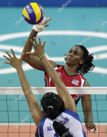 Danielle Scott-Arruda, Aleoscar Blanco Danielle Scott-Arruda, right, the USA, spikes the ball against Venezuela's Aleoscar Blanco during their women's volleyball preliminary match at the Beijing 2008 Olympics in Beijing, China. Scott-Arruda never really thought she was very good at volleyball, so it's a good thing that others saw her differently