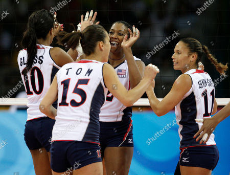 Danielle Scott-Arruda, Kimberly Glass, Logan Tom, Robyn Ah Mow-Santos USA's Danielle Scott-Arruda (2), center rear, Kimberly Glass (10), Logan Tom (15) and Robyn Ah Mow-Santos (11) celebrate after scoring a point against Poland during their women's volleyball preminary match at the Beijing 2008 Olympics in Beijing, China. Scott-Arruda never really thought she was very good at volleyball, so it's a good thing that others saw her differently