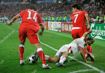 Ivica Vastic, Euzebiusz Smolarek Poland's Euzebiusz Smolarek, center, challenges for the ball with Austria's Gyorgy Garics, left, and Ivica Vastic during the group B match between Austria and Poland in Vienna, Austria, at the Euro 2008 European Soccer Championships in Austria and Switzerland