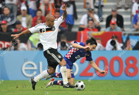 Stock Image of David Odonkor, Danijel Pranjic Germany's David Odonkor, left, and Croatia's Danijel Pranjic challenge for the ball during the group B match between Croatia and Germany in Klagenfurt, Austria, at the Euro 2008 European Soccer Championships in Austria and Switzerland