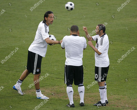 David Odonkor, Kevin Kuranyi, Oliver Neuville German substitute players, from left, Kevin Kuranyi, David Odonkor and Oliver Neuville chat prior to the semifinal match between Germany and Turkey in Basel, Switzerland, at the Euro 2008 European Soccer Championships in Austria and Switzerland