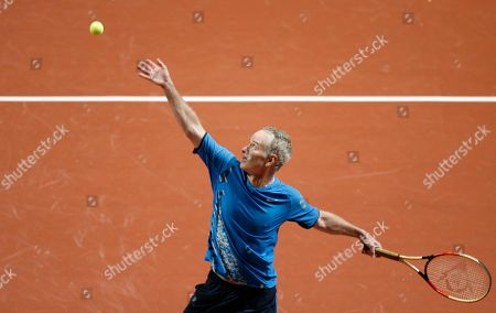 John McEnroe Former professional tennis star John McEnroe, from the United States, serves to Pato Clavet of Spain, during their match at the 'Master Senior Comunidad de Madrid' in Madrid