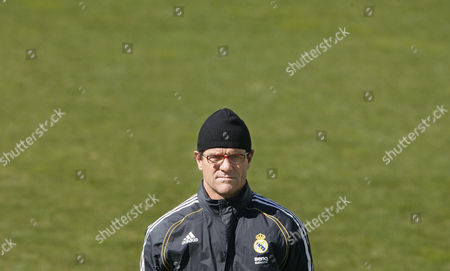 Fabio Capello Real Madrid coach Fabio Capello, from Italy, is seen during a training session of his team at Valdebebas stadium, in Madrid, . Real Madrid's elimination from the Champions League on Wednesday has cast doubt on whether Fabio Capello will continue as team coach. Madrid sports director Predrag Mijatovic couldn't confirm that Capello would be in charge for the team's visit to its biggest rival, FC Barcelona, in Saturday's Spanish league game