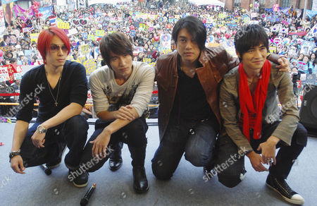 """The popular Taiwanese pop band F4, from left, Vanness Wu, Jerry Yan, Ken Chu and Vic Chou, pose for photographers during an event to promote their new CD """" Waiting for You,"""", in Taipei, Taiwan"""