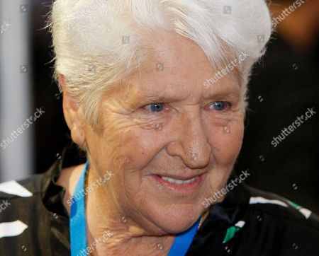 """Dawn Fraser In this photo, former Australian swimmer Dawn Fraser walks the red carpet during the world premier of """"Australia"""", in Sydney. Fraser will return to Japan this week to celebrate the 50th anniversary of the Tokyo Olympics, where she won fame in the pool and notoriety outside the arena. Fraser won the 100-meter freestyle in the Tokyo Olympics in 1964"""