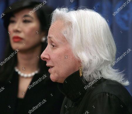 Andrea Jung, left, chief executive officer of Avon, and Joanne Sandler, executive director of UNIFEM, listen during a press conference at the United Nations in New York, . Avon and UNIFEM, the United Nations Development Fund for Women, announced a partnership to promote women's economic empowerment and end violence against women