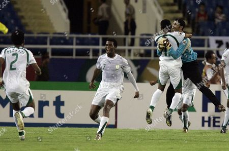 Yasser Al Mosailem Saudi Arabia's players including goalie Yasser Al Mosailem, right,celebrate their 3-2 victory against Japan after Asian Cup soccer semifinal match at My Dinh Stadium in Hanoi