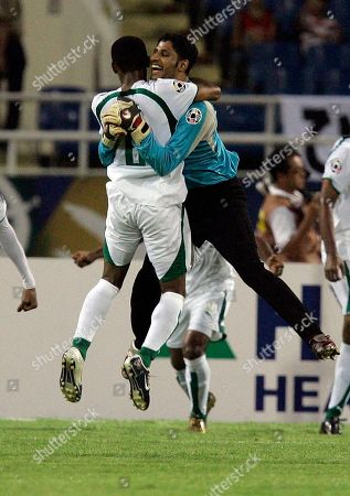 Yasser Al Mosailem Saudi Arabia's goalie Yasser Al Mosailem, right,celebrates with an unidentified teammate after their 3-2 victory against Japan after Asian Cup soccer semifinal match at My Dinh Stadium in Hanoi