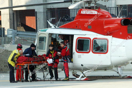 United States skier Lindsey Kildow arrives on a stretcher by helicopter to CTO (Centro Traumatologico Ospedauero, Center for Trauma Treatment) Hospital in Turin, Italy . American gold medal contender Lindsey Kildow crashed badly on her downhill training run and was taken down the mountain on a stretcher, moments after defending Olympic champion Carole Montillet-Carles of France also was carried off