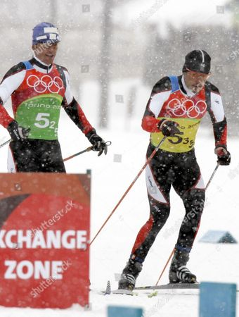 """Juergen Pinter, Roland Diethart FILE **Austria's Juergen Pinter, left, changes to Roland Diethart during the Men's Cross Country 4x10k relay at the Turin 2006 Winter Olympic Games in Pragelato Plan, Italy, Feb. 19, 2006. The head of the Austrian Ski Federation vowed that his organization would """"get to the bottom"""" of a doping scandal at the 2006 Winter Games in Turin that has led to the banning for life of six Austrian athletes from the Olympics. The IOC identified the banned Austrians as retired biathletes Wolfgang Perner and Wolfgang Rottmann, and cross-country skiers Martin Tauber, Juergen Pinter, Johannes Eder and Roland Diethart"""